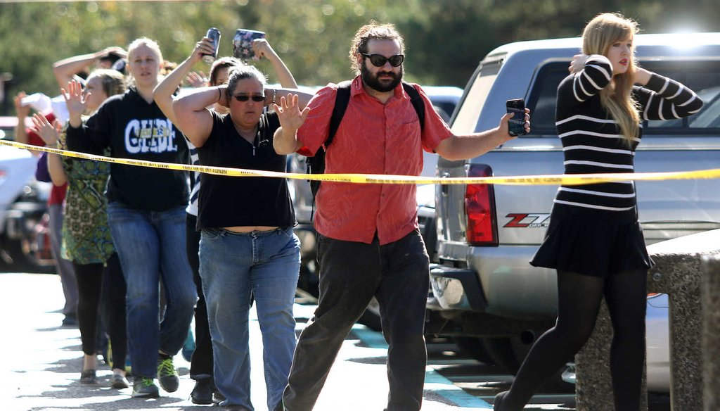 Students, staff and faculty are evacuated from Umpqua Community College in Roseburg, Ore., after a deadly shooting there. (AP)