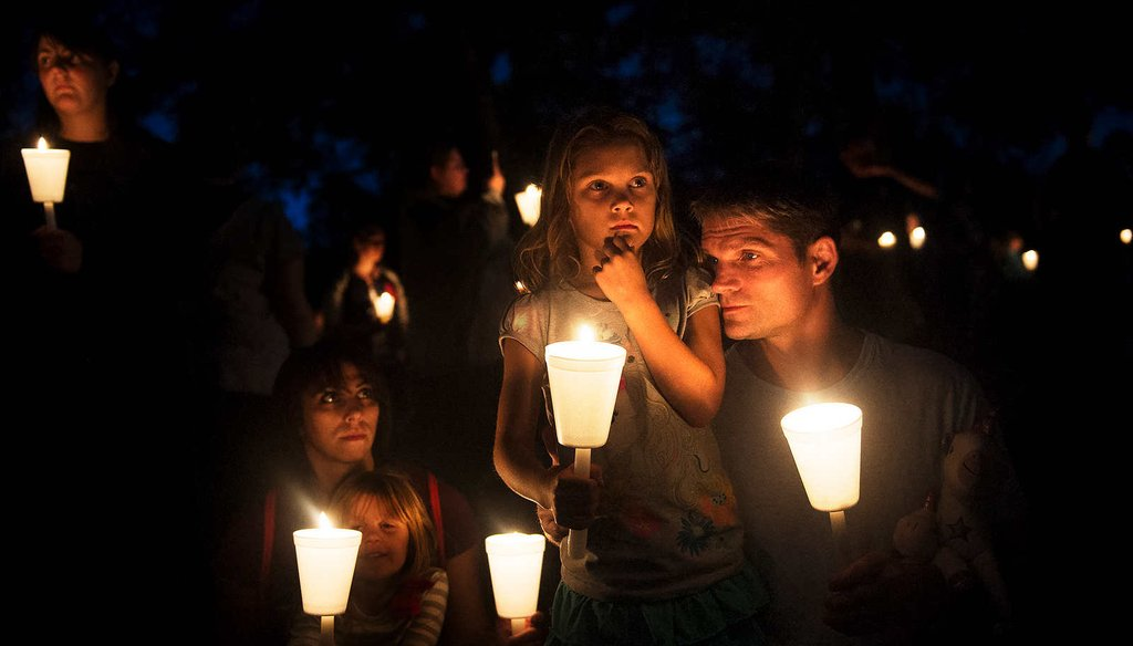 Residents honor victims of a shooting at Umpqua Community College in Roseburg, Ore.  The rampage killed nine and wounded seven. (New York Times)