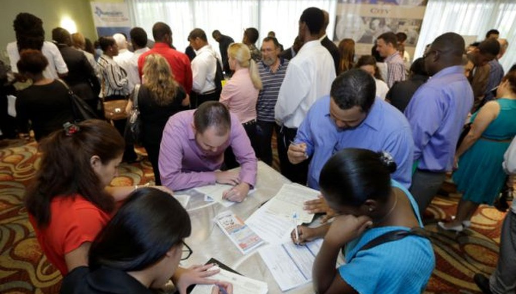 Job seekers attend a job fair in Miami Lakes, Fla., on Oct. 22, 2014.