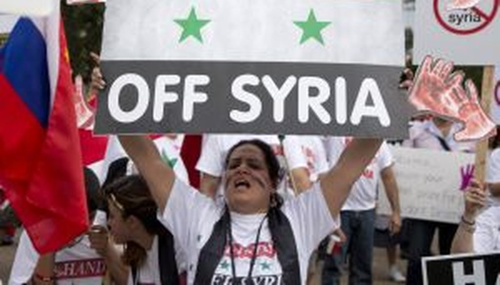 Protesters against U.S. military action in Syria shout during a demonstration in front of the White House on Monday. On Tuesday, President Barack Obama will address the nation regarding Syria. (AP Photo/Carolyn Kaster)
