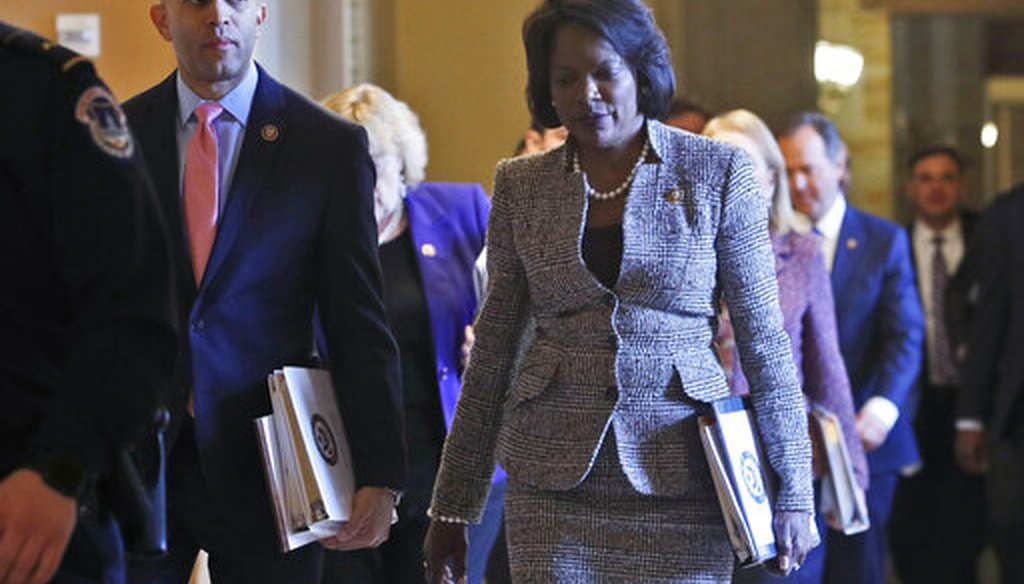 House Democratic impeachment managers, Rep. Hakeem Jeffries, D-N.Y., left, and Rep. Val Demings, D-Fla., right, walk to the Senate chamber for the impeachment trial of President Donald Trump at the Capitol Wednesday Jan 29, 2020, in Washington. (AP_