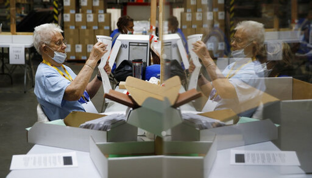 In this June 9, 2020, file photo election workers process mail-in ballots during a nearly all-mail primary election in Las Vegas. (AP)