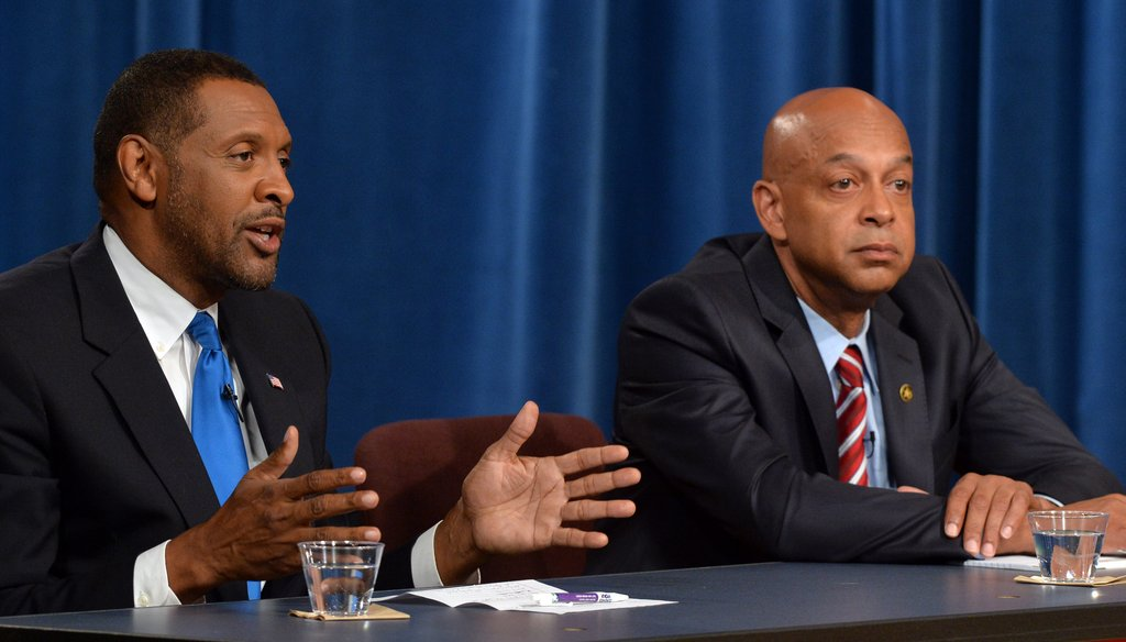 Vernon Jones, right, makes a point during a recent debate
