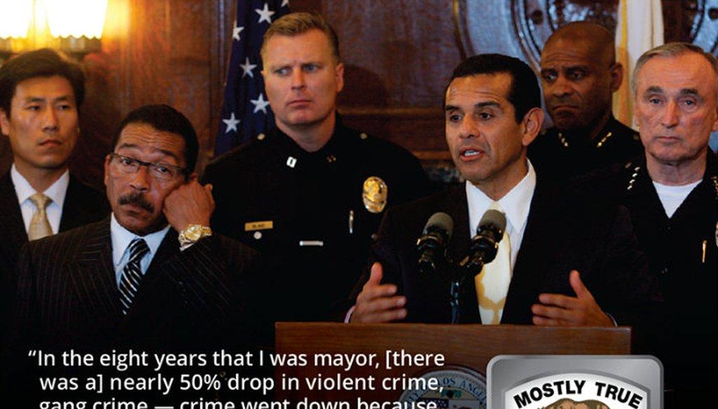 Then Los Angeles Mayor Antonio Villaraigosa, at podium, and Los Angeles Police Chief William Bratton, far right, take questions at City Hall in Los Angeles in March 2008. (AP Photo/Damian Dovarganes)