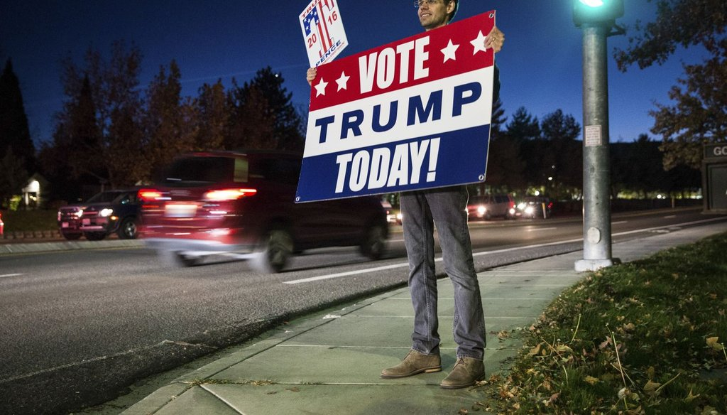 As the polls close, a supporter holds a sign for Donald Trump in Reno, Nev., Nov. 8, 2016. (NY Times)