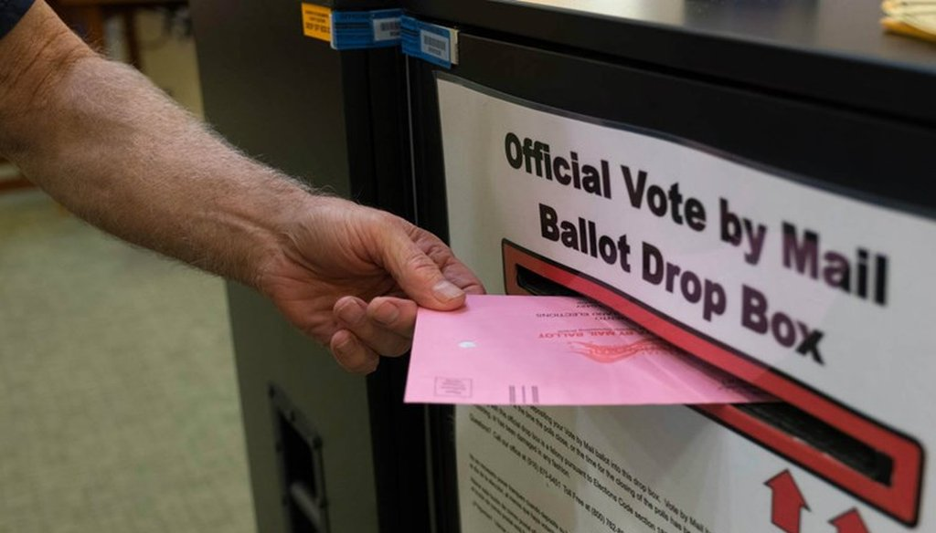 A voter returns a vote by mail ballot in California. Andrew Nixon / CapRadio