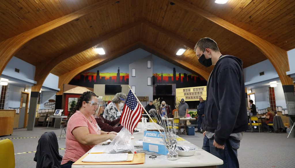 Voters across the country, like this man in Idaho, went to the polls. (AP Photo/Otto Kitsinger)