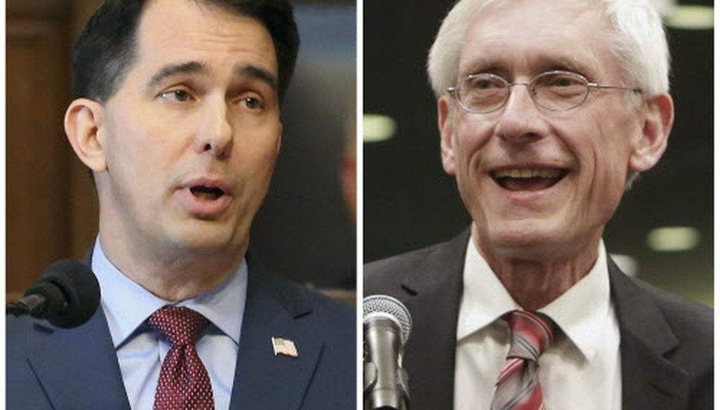 Wisconsin GOP Gov. Scott Walker (left) and Democratic Gov.-elect Tony Evers.