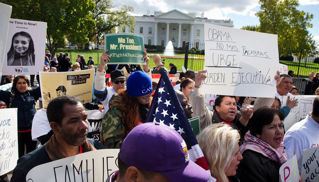 People rally for comprehensive immigration reform, Friday, Nov. 7, 2014, outside of the White House. With executive action to defer deportations on the table, Republicans are split on how to respond. (AP Photo)