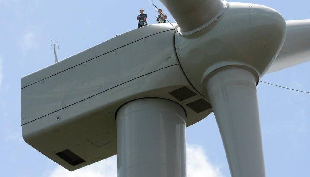 Workers stand on top of a land-based wind turbine in northeastern North Carolina. News & Observer photo.