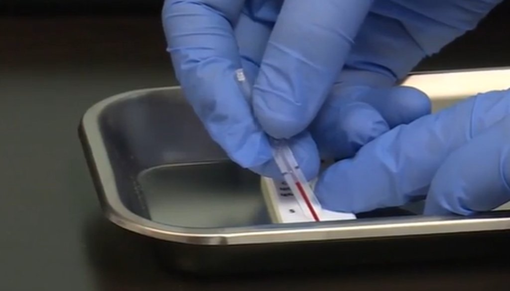 A researcher processes a coronavirus antibody test. (WRAL screenshot)