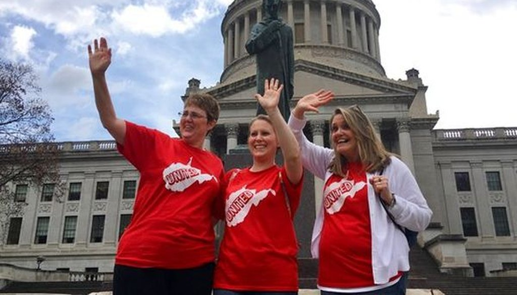 Striking teachers Michelle Myers, left, Holly O'Neil, center, and Suzanne Varner of McNinch Primary School in Moundville, W.Va., outside the state capitol in Charleston, W.Va, on Feb. 23, 2018. (AP/John Raby)