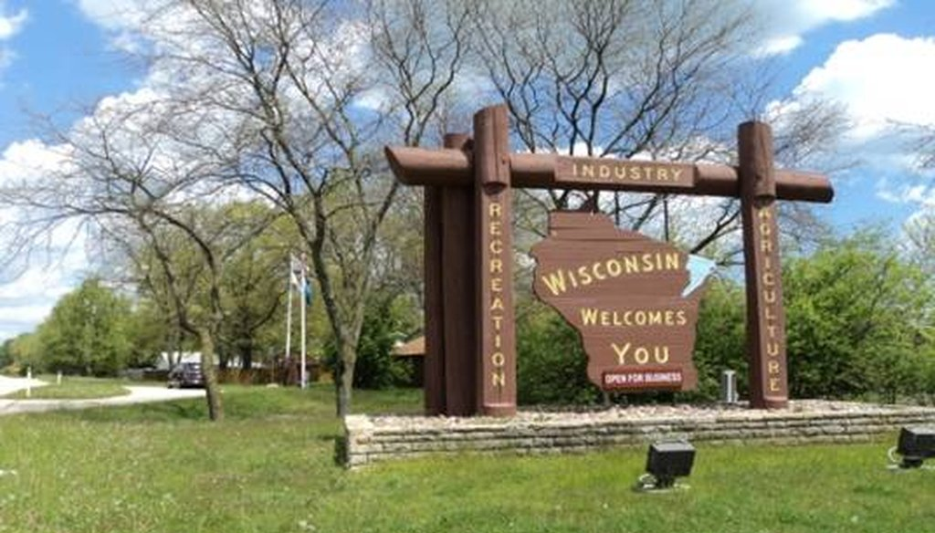 """Wisconsin Welcomes You"" signs are posted near the state's borders."