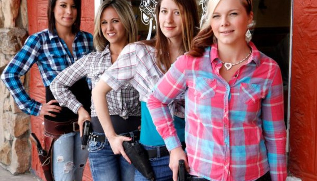 Waitresses Ashlee Saenz, Lauren Boebert, Jessie Spaulding, and Dusty Sheets pose with their sidearms in front of the Shooters Grill in Rifle, Colo., on June 23, 2014. The western Colorado restaurant encourages the open display of firearms.