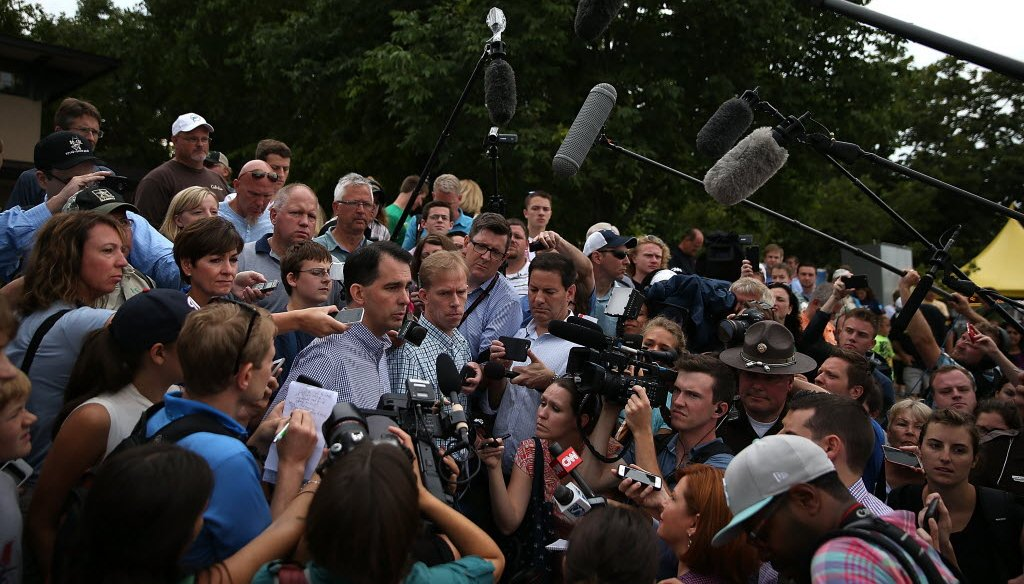 Gov. Scott Walker talks to the media Aug. 17, 2015 at the Iowa State Fair -- where he initially made comments on 'birthright citizenship' that he has been working to untangle. (Image from Getty)