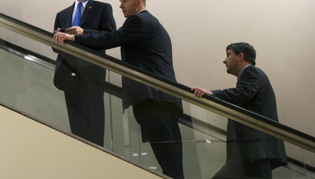 Wisconsin Gov. Scott Walker, left, leaves a meeting during the National Governors Association winter meeting in Washington, D.C., on Feb. 22, 2014