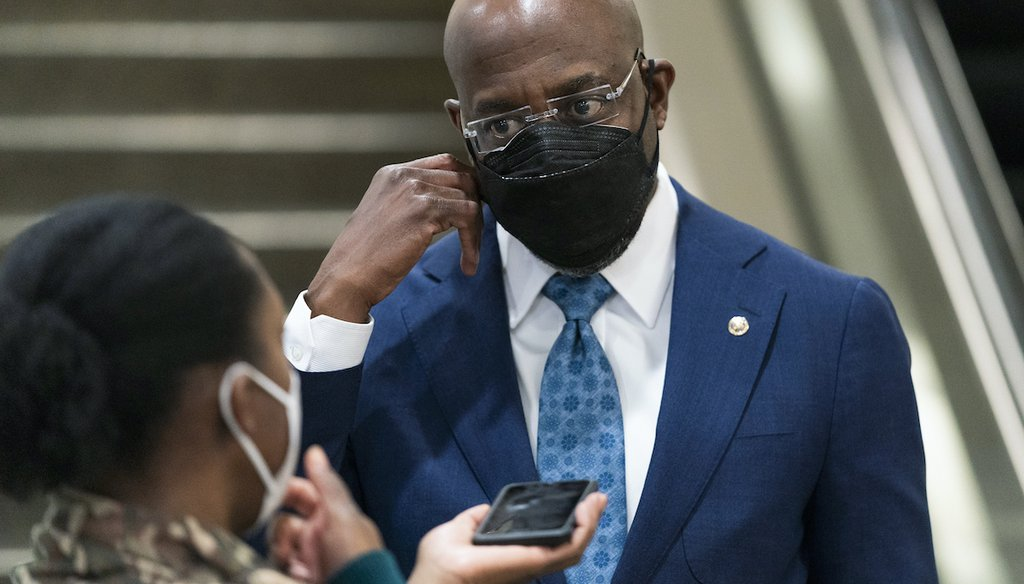 Sen. Raphael Warnock, D-Ga., right, talks to a reporter as he leaves the Capitol at the conclusion of the second day of the second impeachment trial of former President Donald Trump, on Capitol Hill in Washington, Wednesday, Feb. 10, 2021. (AP)