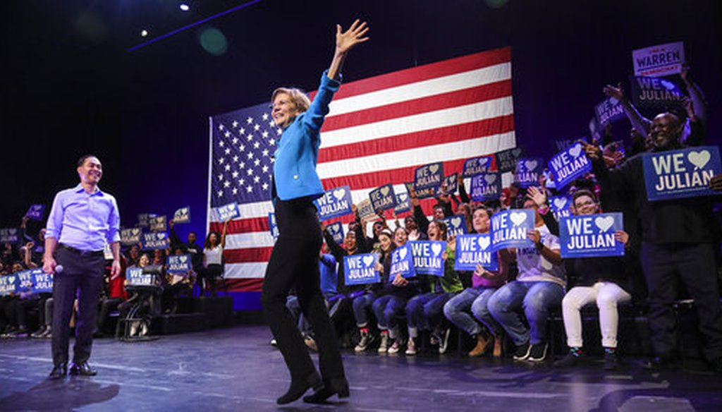 Democratic presidential candidate Sen. Elizabeth Warren, D-Mass., gets the endorsement of former presidential candidate Julian Castro at a rally in Brooklyn, NY. (AP Photo/Bebeto Matthews)
