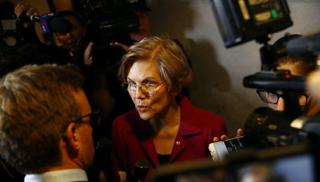 Sen. Elizabeth Warren, D-Mass., speaks with reporters inside the Hart Senate Office Building on Capitol Hill. (AP Photo/Patrick Semansky)