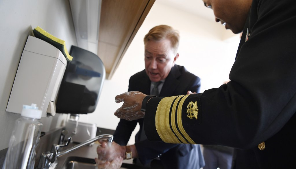 U.S. Surgeon General Vice Admiral Jerome M. Adams demonstrates how to wash hands with Connecticut Gov. Ned Lamont during a visit to the State Public Health Laboratory on March 2, 2020. (AP)