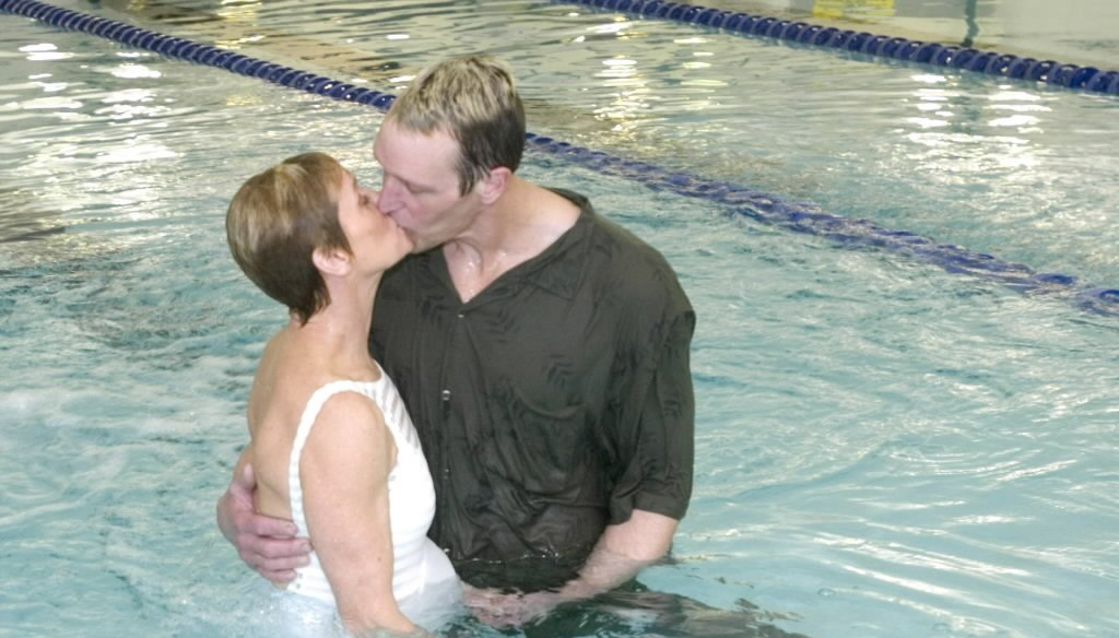 Joanne Wainwright and Mark Confer kiss on March 22, 2008 after they were married in a ceremony at the Nikiski Pool in Nikiski, Alaska. (AP photo)