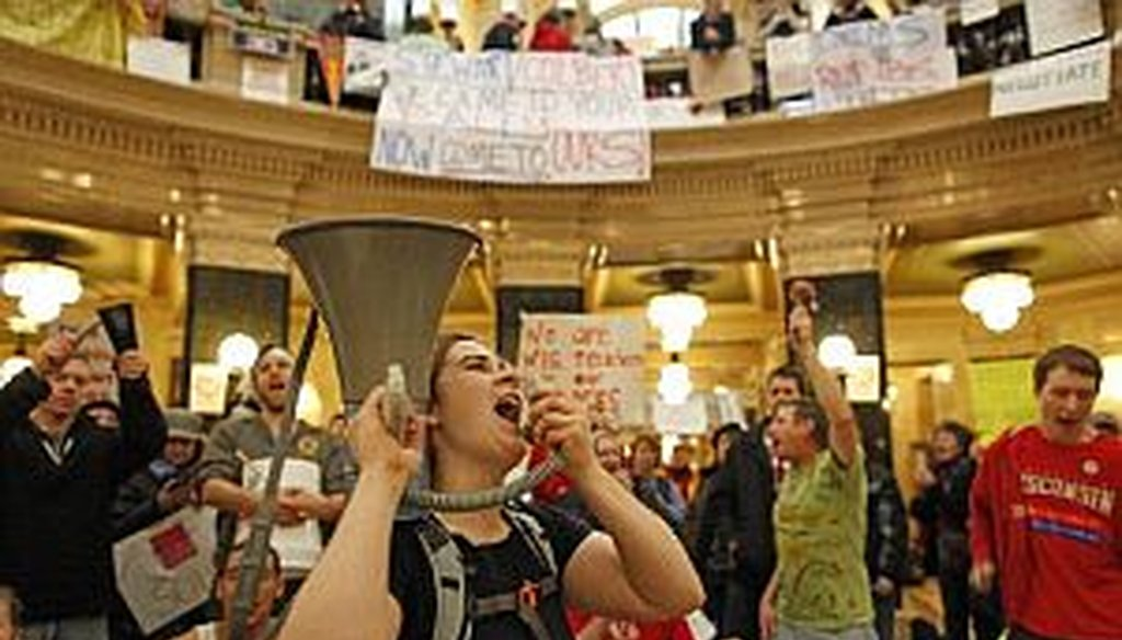 Protesters bang drums and shout slogans inside the state Capitol on Monday.