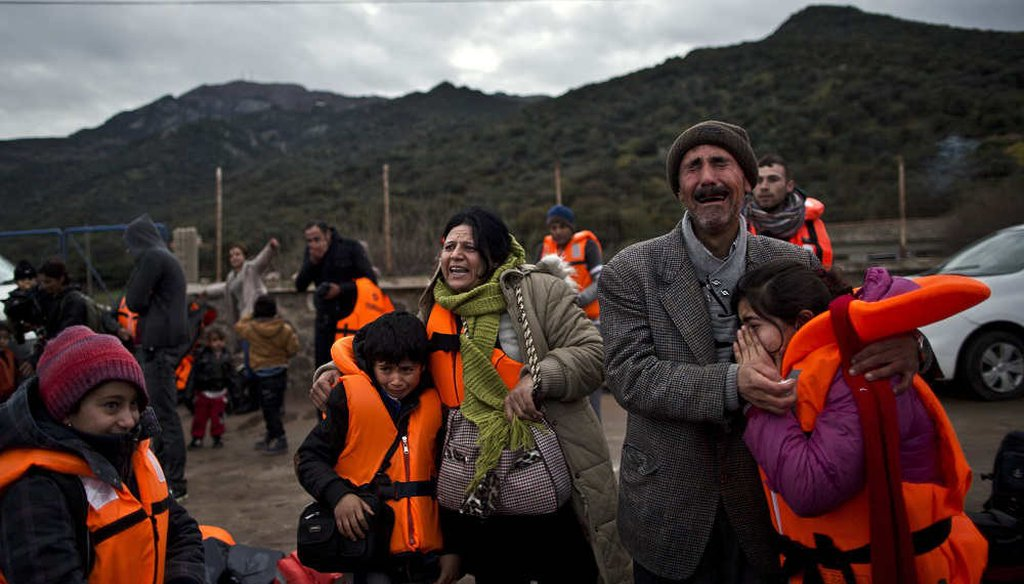 A Yazidi refugee family from Iraq, cry and embrace shortly after arriving on the Greek island of Lesbos in 2015. (AP)