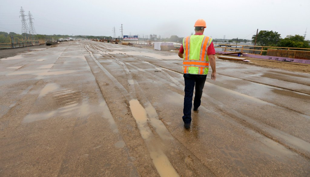 A Wisconsin Department of Transportation project manager walks along part of the Zoo Interchange reconstruction in the Milwaukee area in September 2016. (Mike De Sisti/Milwaukee Journal Sentinel)