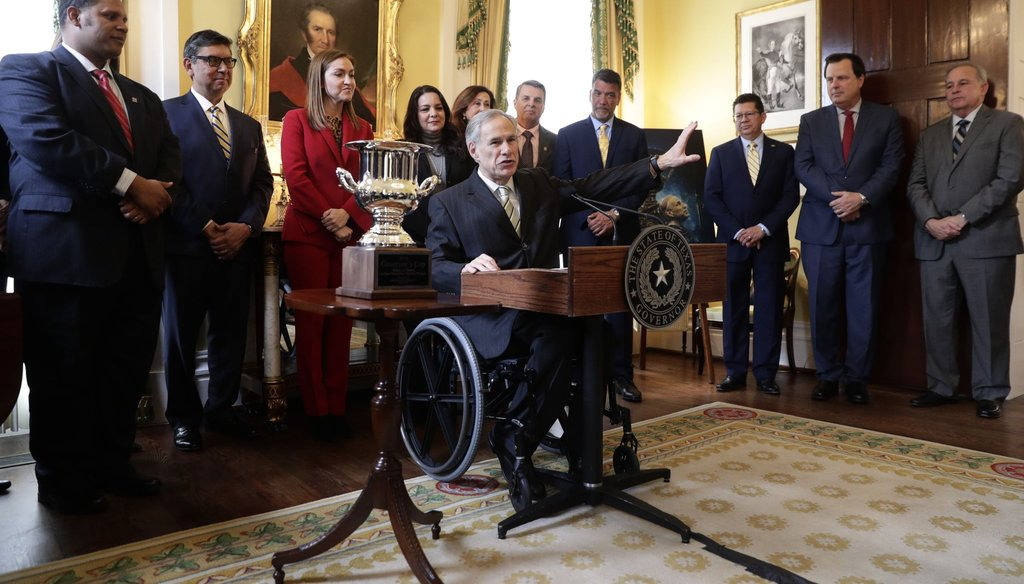 Texas Gov. Greg Abbott receives the Governor's Cup from Site Selection Magazine in Austin in March.(AP Photo/Eric Gay)