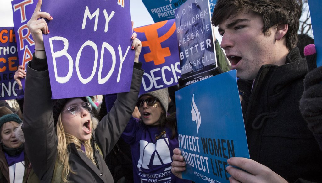 Pro-choice advocates, left, and anti-abortion advocates, right, rally outside of the Supreme Court on March 2, 2016 in Washington. (Drew Angerer / Getty Images.)
