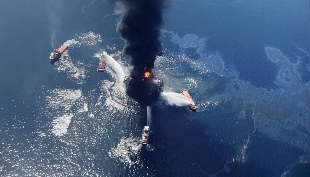 In this April 21, 2010 aerial file photo taken in the Gulf of Mexico more than 50 miles southeast of Venice on Louisiana's tip, an oil slick is seen as the Deepwater Horizon oil rig burns. (AP Photo)