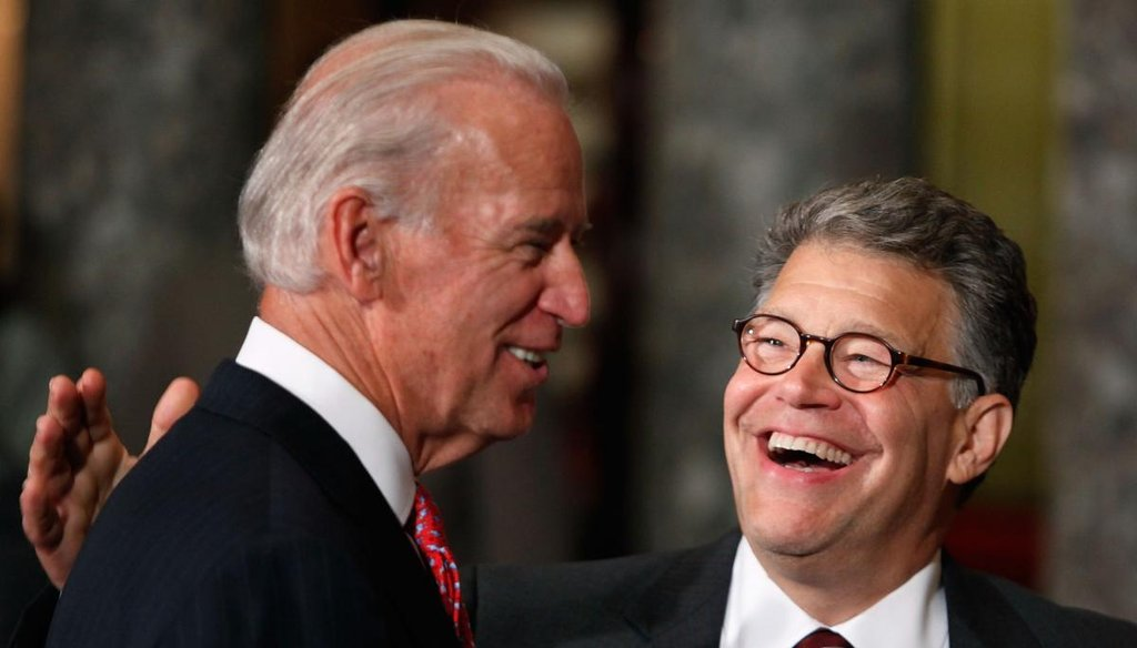 Sen. Al Franken, D-Minn., laughs during his swearing-in ceremony at the Capitol on July 6, 2009, with Vice President Joe Biden. (Getty)
