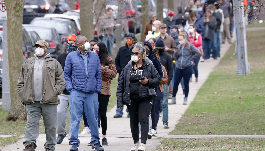 Voters wait in line outside Riverside High School in Milwaukee during the April 7, 2020, election. Mike De Sisti / Milwaukee Journal Sentinel