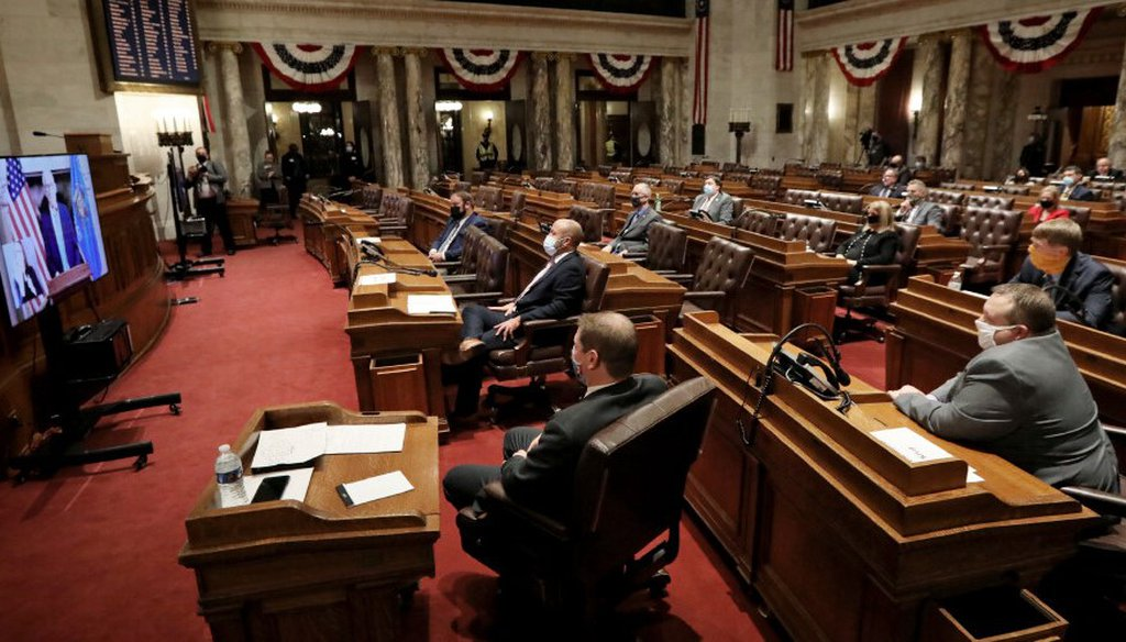 Wisconsin Gov. Tony Evers delivers his State of the State address virtually as members of the Assembly watch from the Assembly Chambers at the Wisconsin State Capitol in Madison, Wis., Tuesday, Jan. 12, 2021. (Amber Arnold/Wisconsin State Journal via AP)