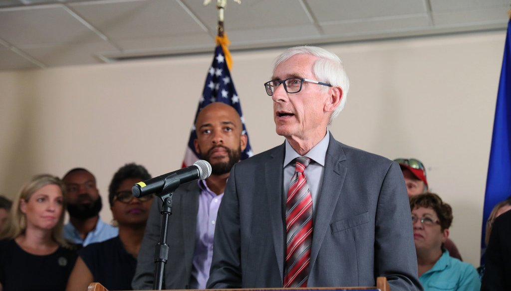 Gov. Tony Evers, center and Lt. Governor Mandela Barnes, left, spoke at a press conference on expanding Medicaid in Wisconsin on Aug. 5, 2019. Michael Sears/Milwaukee Journal Sentinel