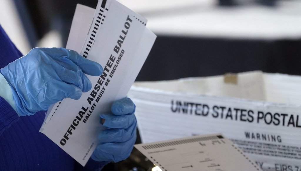 A worker at the Fulton County Board of Registration and Elections works to process absentee ballots at the State Farm Arena Monday, Nov. 2, 2020, in Atlanta. (AP)