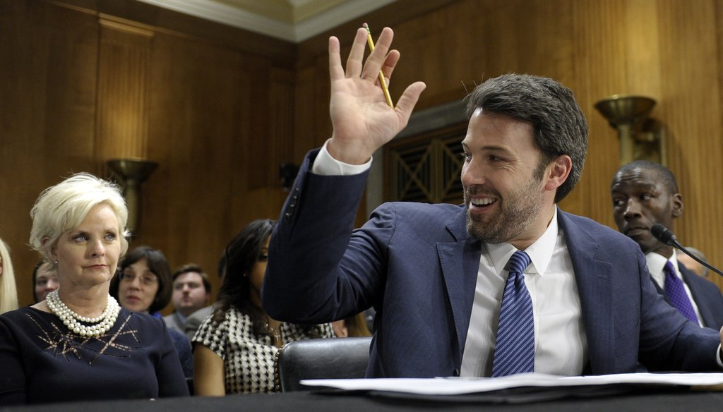 Ben Affleck testifies on Capitol Hill about his work in the Congo on Feb. 26, 2014, as Cindy McCain listens behind him. AP