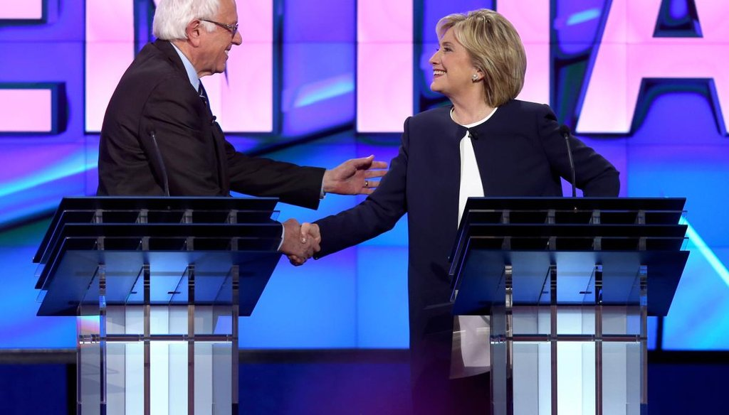 Vermont Sen. Bernie Sanders and former Secretary of State Hillary Clinton share a light-hearted moment at the end of the first Democratic debate in Las Vegas on Oct. 13, 2015. (Getty)