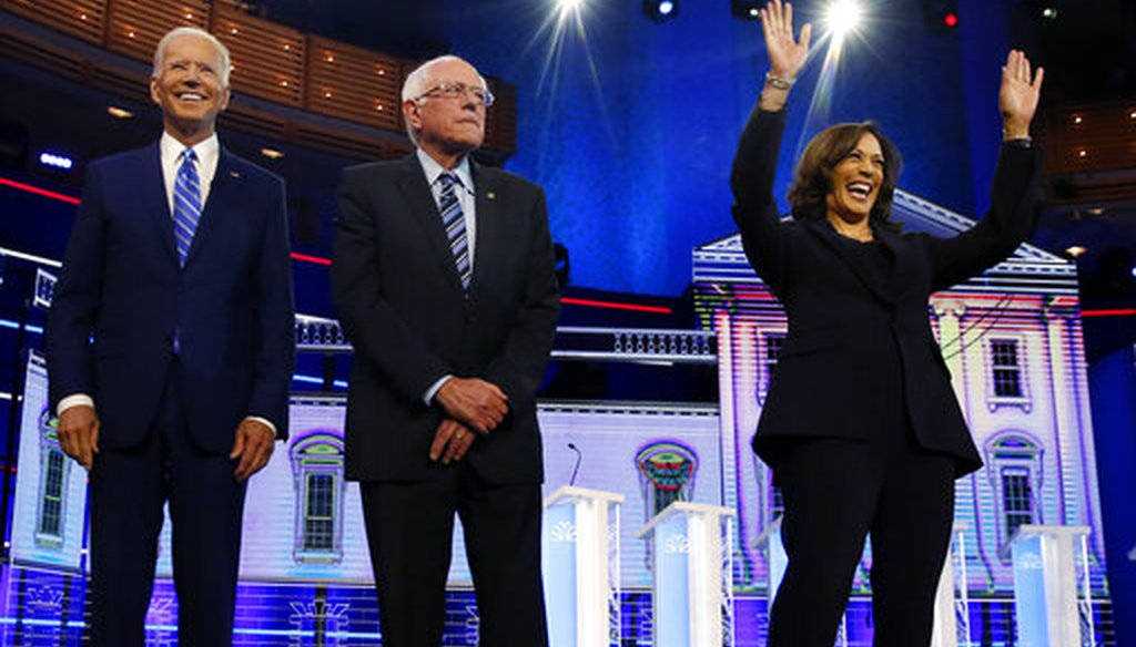 Democratic presidential candidates former vice president Joe Biden, left, Sen. Bernie Sanders, I-Vt., and Sen. Kamala Harris, D-Calif., right, stand on stage for the Democratic primary debate, Wednesday, June 27, 2019, in Miami (AP).