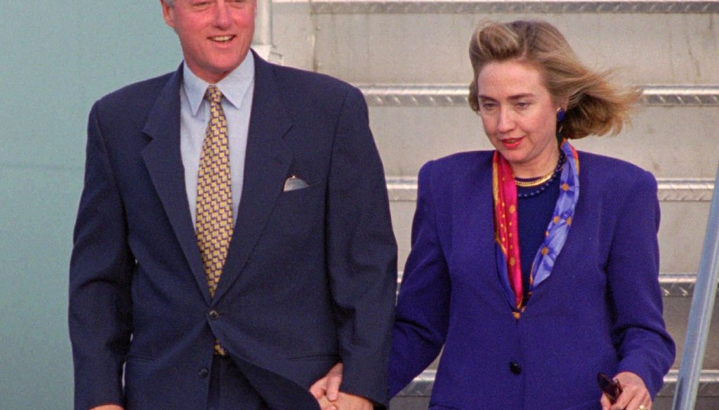 Former President Bill Clinton and First Lady Hillary Rodham Clinton arrive at Miami International Airport Oct. 15, 1994. (AP Photo/Marta Lavandier)