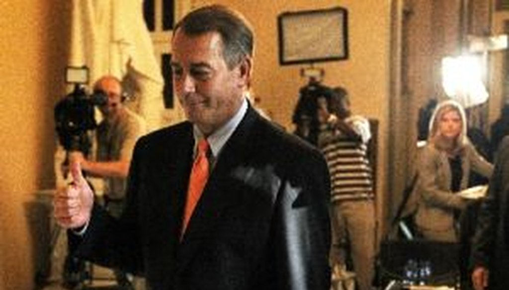 House Speaker John Boehner, R-Ohio, gives a thumbs up as he passes reporters in the Capitol after a key debt-ceiling vote on July 29, 2011.