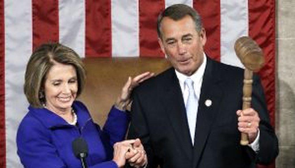 Rep. Nancy Pelosi turns over the gavel to the new House Speaker, Rep. John Boehner.