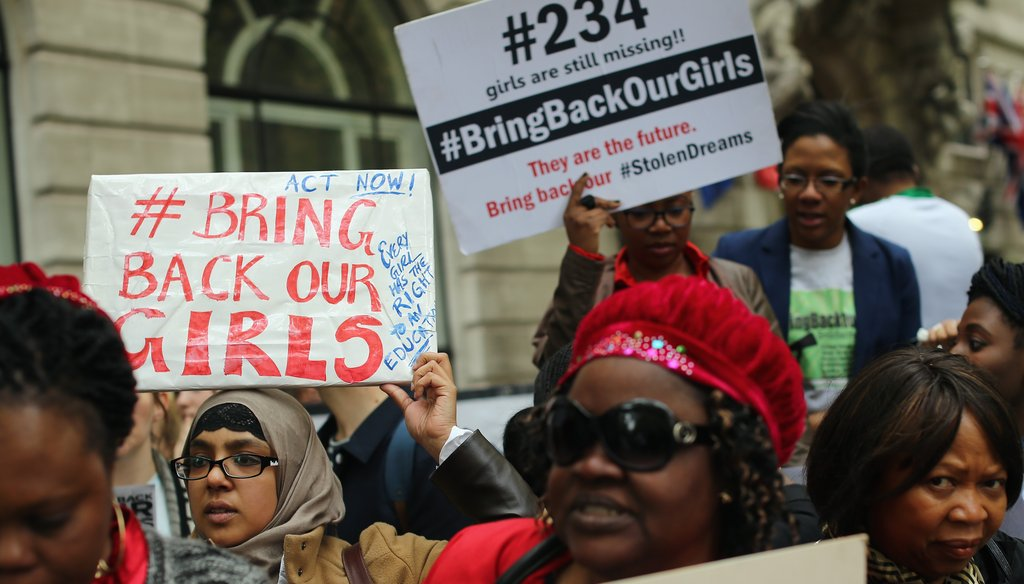 Protesters around the world, including these in London, are demanding the return of 276 kidnapped school girls in Nigeria. Getty photo.