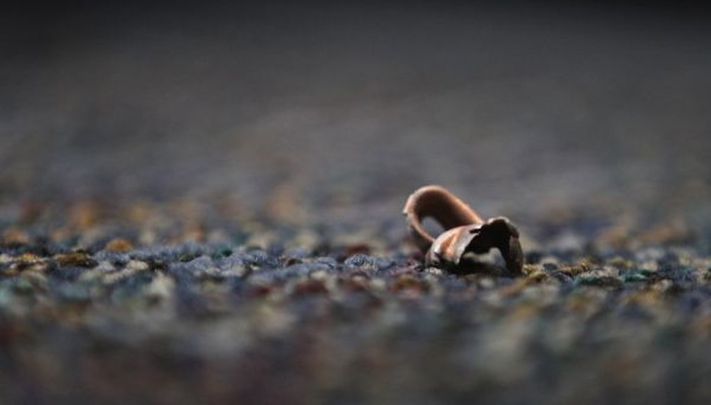 A bullet fragment or casing found in Austin, Texas, following an incident in which a gunman, Larry Steve McQuilliams, targeted several buildings before being shot and killed by police on Nov. 29, 2014. (Laura Skelding/Austin American-Statesman/TNS)