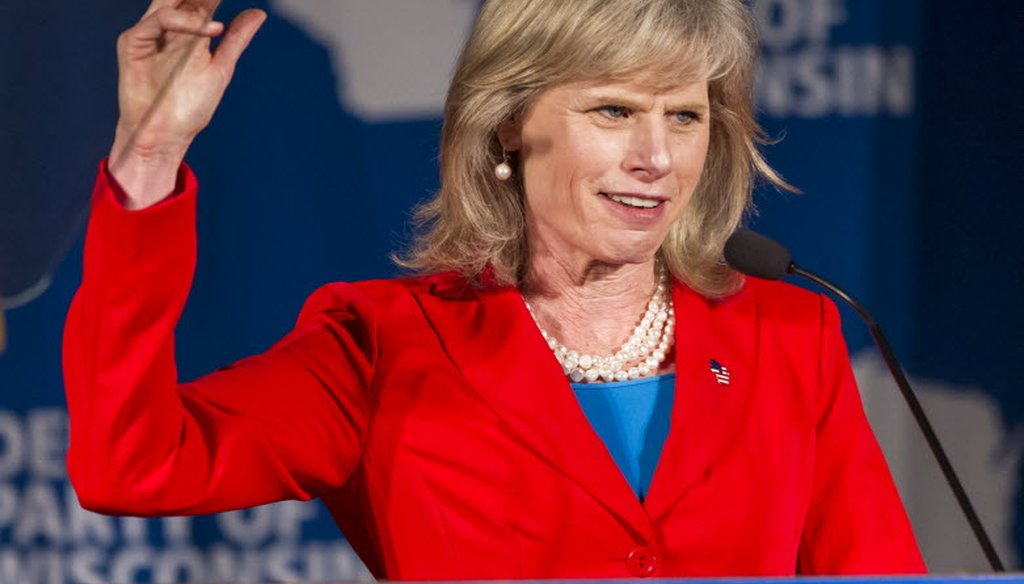 Democratic gubernatorial candidate Mary Burke addresses delegates at the Democratic Party of Wisconsin convention Friday, June 6, 2014, in Lake Delton, Wis. (AP Photo/Andy Manis)