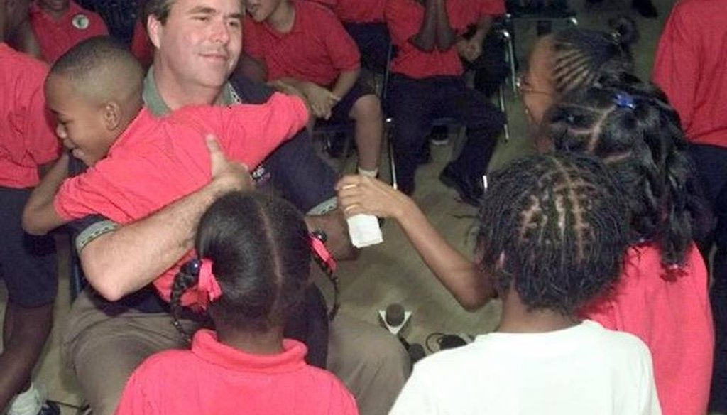 In 1998, Jeb Bush, then governor-elect, visited students at Liberty City Charter School which he co-founded. The school later closed. (AP)