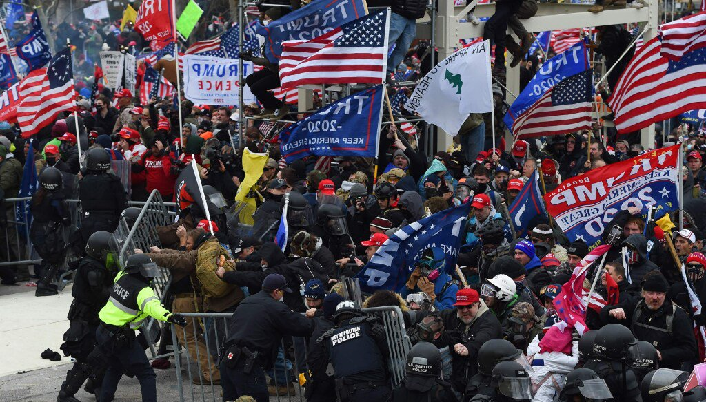 Trump supporters clash with police and security forces outside the U.S. Capitol in Washington D.C on Jan. 6, 2021. (Photo by ROBERTO SCHMIDT / AFP)