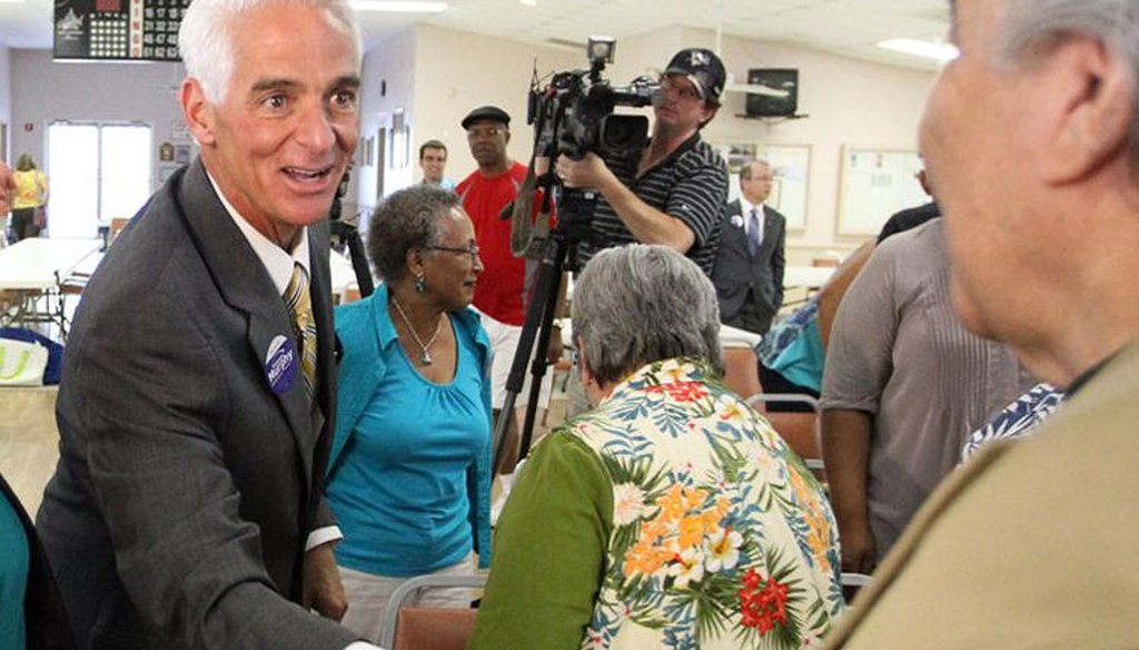 Charlie Crist greets a voter on the campaign trail. (Tampa Bay Times photo)