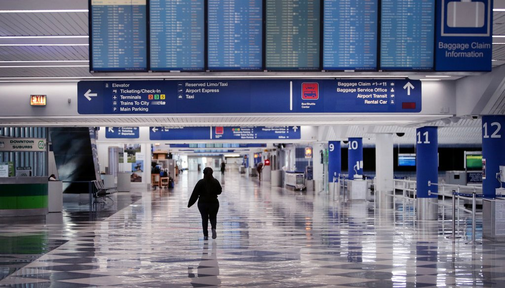 A worker walks through a baggage claim area at a nearly-empty O'Hare International Airport on April 2, 2020 in Chicago, Illinois. (Photo by Scott Olson/Getty Images)