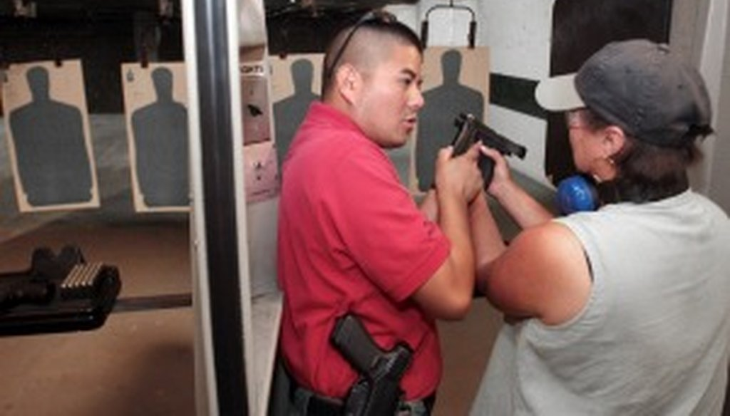 State Rep. Vicki Truitt works with a concealed handgun license instructor in 2008.